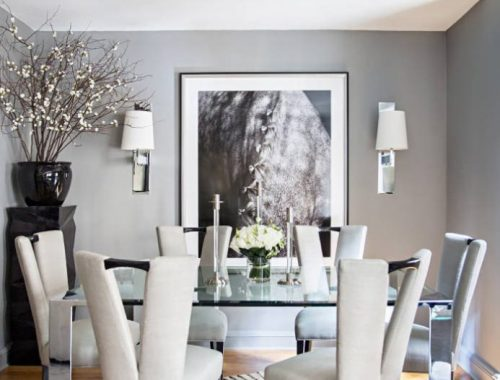 Ryan-Korban-NYC-apt-dining-room-gray-silver-chrome-zebra-rug-horse-photo-ivory-chairs